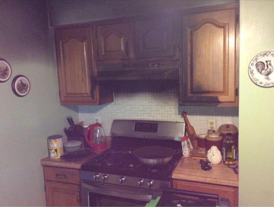 Cooking fire caused heavy smoke damage to stove top and cabinets.