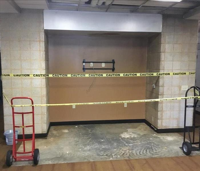 Smoke damage was caused by a fire in this college dorm common room.